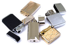 Group of lighters on white background Stock Photography