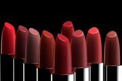 A group of lipsticks of different colors royalty free illustration