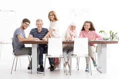 Group of listeners sitting at the table during the language course Stock Photos