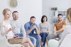 Group listening to the woman. Group listening to the women during psychotherapy session Royalty Free Stock Photo