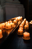 Group of lit votive candles in church Royalty Free Stock Photos