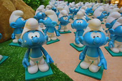 Group of little blue smurfs staring and looking Stock Photo