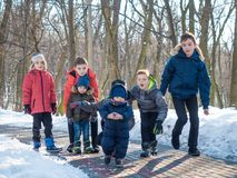 Funny little boys in winter park. Group of little boys have fun at the nature. Children spend leisure time outdoors in winter park Royalty Free Stock Image
