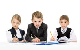 Group of little business people at the table Royalty Free Stock Photography