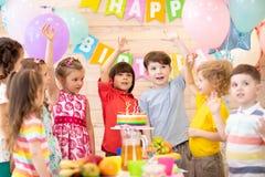 Group of 3-5 aged children celebrating birthday party merrily. Group of little children celebrating birthday merrily, Excited friends. Cheerful excited kids stock image