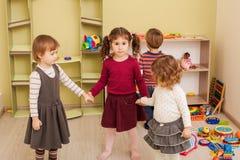 Group of little children dancing Stock Image