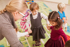 Group of little children dancing Stock Photography