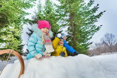 Group of little children play snowball in fortress stock images