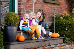 Kids at house porch on autumn day Royalty Free Stock Photo