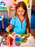 Group little girl with brush painting in Royalty Free Stock Photography