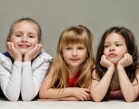 Group of little girls lying Royalty Free Stock Images