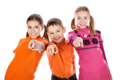 Group of little kid standing point finger at you Royalty Free Stock Photos