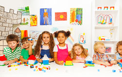 Group of little kids friends play with blocks Royalty Free Stock Photography