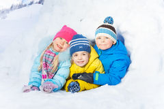 Group of little kids play in snow igloo Stock Photo