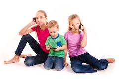Group of little kids using electronic devices Stock Images