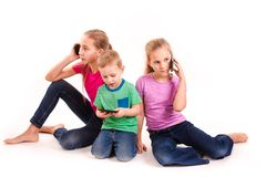 Group of little kids using electronic devices Royalty Free Stock Images