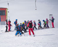 Group of little skiers with instructor are preparing for the descent of the mount. Austria, Zams on 22 Feb 2015 Royalty Free Stock Image