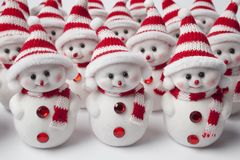 Group of little snow men standing in a row  Royalty Free Stock Photos