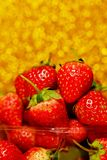 Group of little strawberry soft focus with romantic golden glitter bokeh background. stock images