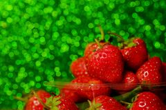 Group of little strawberry soft focus with romantic green glitter bokeh background. Have some space for write wording stock photos