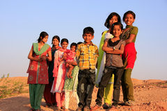 Group of local kids playing near water reservoir, Khichan villag Stock Photography