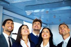 Group looking up with dreaming expression. Happy positive business group looking up with dreaming expression Royalty Free Stock Photos