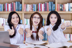 Group of lovely students with thumbs up Royalty Free Stock Photography