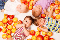 Group lying in apples Royalty Free Stock Image