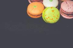 Group of macarons on black with free space Royalty Free Stock Photos