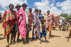 Group of Malagasy mens. ITAMPOLO, MADAGASCAR - OCT 19: Group of Malagasy mens unidentified of ethnic Antandroy in the weekly market of Itampolo in the deep south stock photo