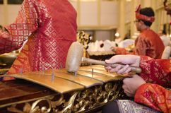 Group of Malaysian with songket performing Gamelan Orchestra on. Hotel stage Royalty Free Stock Images