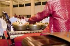 Group of Malaysian with songket performing Gamelan Orchestra on. Hotel stage Stock Image