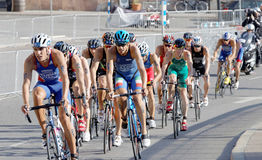 Group of male cycling triathlon competitors fighting Royalty Free Stock Photography
