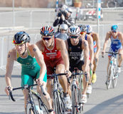 Group of male cycling triathlon competitors fighting Stock Photo