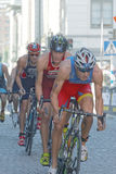 Group of male cycling triathlon competitors Royalty Free Stock Photography