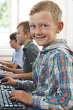 Group Of Male Elementary School Children In Computer Class. Male Elementary School Children In Computer Class Stock Images