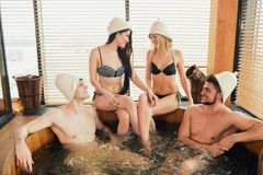 Group of caucasian diverse friends enjoying jacuzzi in hotel spa. Group of male and female friends visiting bathhouse in holidays, being overjoyed and happy stock photos