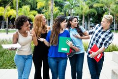 Group of male and female students walking to university Royalty Free Stock Photo