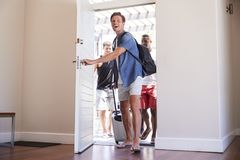 Group Of Male Friends Arriving At Summer Vacation Rental Stock Photos