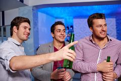 Group of male friends with beer in nightclub Royalty Free Stock Photography