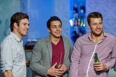 Group of male friends with beer in nightclub Royalty Free Stock Photo