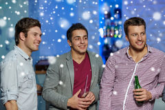 Group of male friends with beer in nightclub Stock Photos