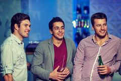 Group of male friends with beer in nightclub Stock Photography