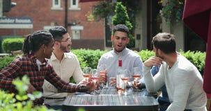 Males Enjoying Wine