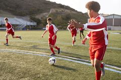Group Of Male High School Students Playing In Soccer Team royalty free stock photography