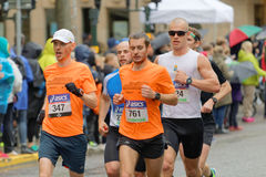 Group of male runner in orange shirts Stock Photography