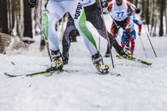 Group of male skiers going uphill front view. Kyshtym, Russia -  March 26, 2016: group of male skiers going uphill front view during Championship on cross Stock Photo