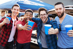 Group Of Male Sports Fans Tailgating In Stadium Car Park Royalty Free Stock Photos