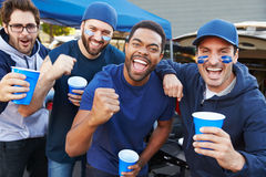 Group Of Male Sports Fans Tailgating In Stadium Car Park Royalty Free Stock Images