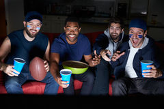 Group Of Male Sports Fans Watching Game On Television Royalty Free Stock Image